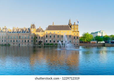 facade of Binnenhof - Dutch Parliament with reflections in pond, The Hague, Holland