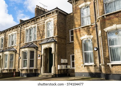 Facade of British Victorian family houses