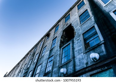 Facade of building with a big hole