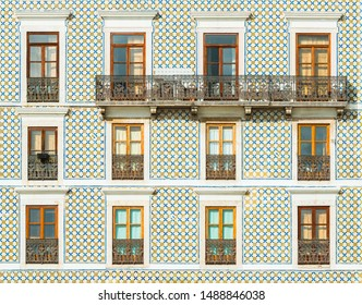 Facade of a building covered with traditional Portuguese tiles. Typical building decoration in Lisbon, Portugal