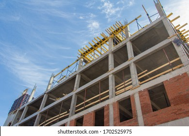 The facade of the building under construction is made of concrete frame and brickwork