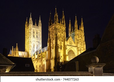 Facade of Canterbury Cathedral illuminated at night, one of the oldest and most important Christian sites in England