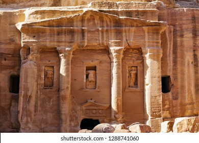 Facade carving in the stone detail in Petra, Jordan