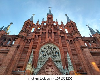 The facade of the Catholic Cathedral of the Immaculate Conception of the Blessed Virgin Mary in Moscow on Malaya Gruzinskaya street in neo-gothic style.