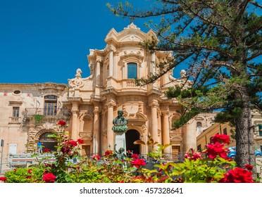 "The facade of the church of St. Dominic - a magnificent specimen ""Sicilian Baroque"" in Noto, Sicily, Italy."
