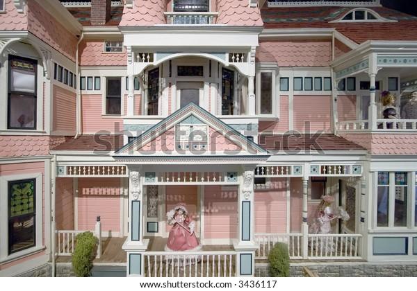 facade of a colonnial design dollhouse