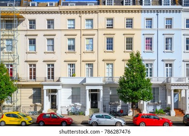 Facade of colourful terraced houses around Pimlico area in London
