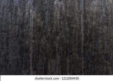Facade cutout with tiles of dark natural slate