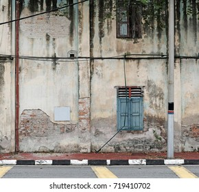 Facade of an dilapidated abandoned building.