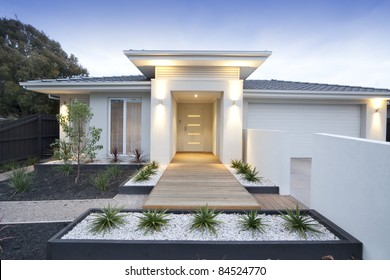 Facade and entry to a contemporary white rendered home in Australia
