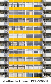 Facade of Great Arthur House, a council housing block faced with panels in yellow colour in London