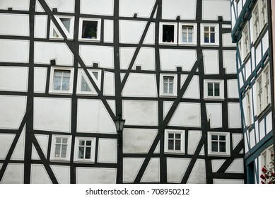 Facade of half-timbered house with triangular windows in Marburg, Germany
