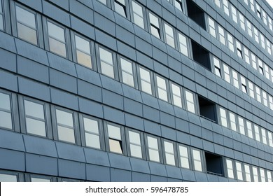 Facade of a highrise clinical building, modern architecture with clean lines, lots of windows and recessed balcony - University Clinic of Göttingen, Germany