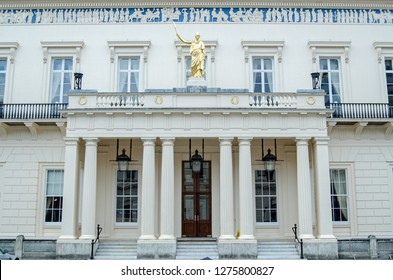 Facade of the historic Athenaeum Club in the St James's district of central London.  Famous for attracting members from science, the club building is adorned with a frieze inspired by the Parthenon
