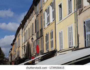 Facade of historical buildings with windows and shutters in Aix-en-Provence, France