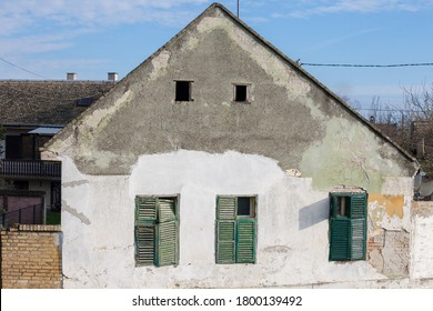 Facade of an hold house building from an abandoned farm of Voivodina, in Serbia. The region of Balkans is hit by a severe rural exodus and emigration deserting the area.