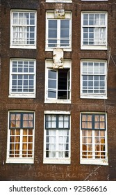 Facade of the Holland house with windows. Amsterdam. Fregment. Frontally