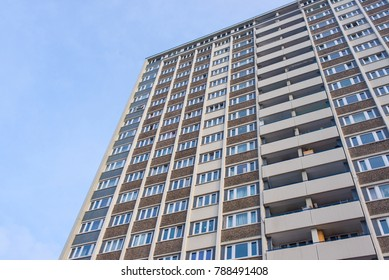 Facade of huge council house tower flat block of apartments viewed from below
