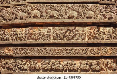 Facade of Indian temple with friezes narrating legends from the Hindu texts. Animals, people and patterns from 12th century, Halebidu, India.
