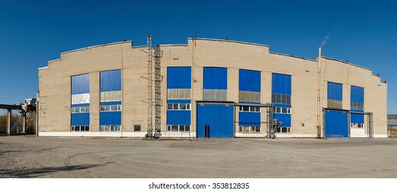 Facade of large industrial warehouse with aluminum panels