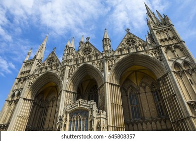 The facade of the magnificent Peterborough Cathedral in the historic city of Peterborough in Cambridgeshire, UK.