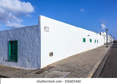 facade of mediterranean house with closed shutterblinds at midday