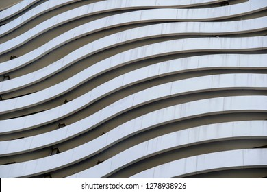 Facade of a modern apartment building. Lines patterns of facade with balcony of building view on exterior and architecture design concept