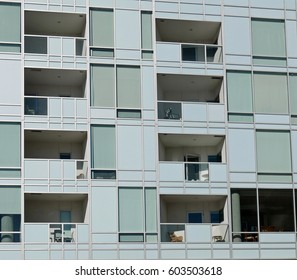 Facade of modern apartment building with set-back balconies