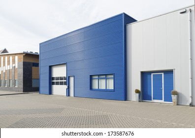 facade of a modern blue warehouse