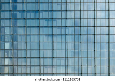Facade of a modern glass fronted office building in Singapore.