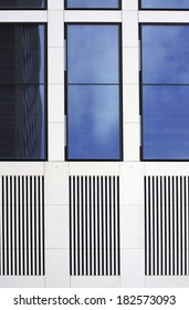 The facade of a modern house with tinted windows and grilles / Tinted windows and grid