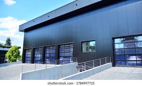 Facade of a modern navy blue warehouse