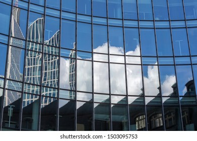 Facade of a modern office building in Frankfurt, Germany, with reflections