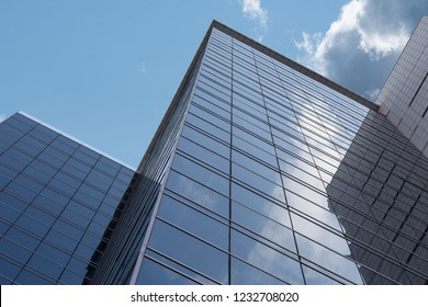 The facade of a multistory building against the blue sky.
