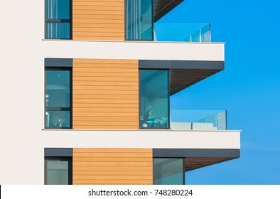 Facade of new apartment glass balcony terrace of modern architecture house