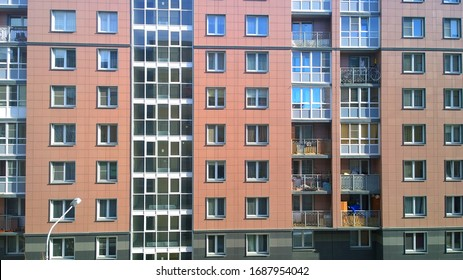 Facade of a new multi-story  residential building. Sale and rental of economy class apartments and comfortable housing. Cityscape. Windows and balconies. City living. Real estate. Stay at home concept