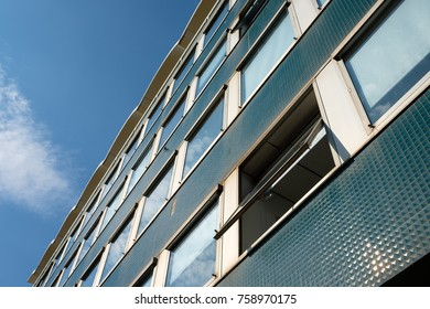 Facade office building with open window of 60s