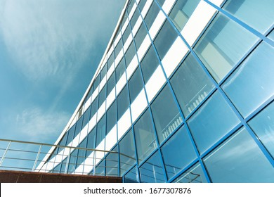 Facade of an office building rising to the sky.