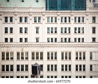facade of an old building in a big city, vintage