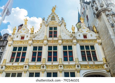 Facade of the Old Civil Registry ( Fietskoetsen ) of Renaissance style in the Burg square in the medieval city of Bruges, Belgium