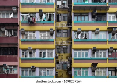 Facade of old colourful tenements near Hennessy Road, Wan Chai, Hong Kong