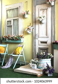 facade of the old house in bright colors decorated with flowers vintage style