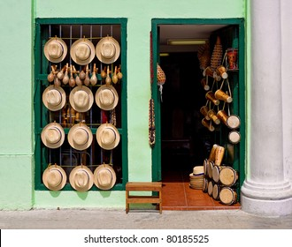 Facade of an old house selling hats, musical instruments,religious necklaces and other traditional craft in Havana
