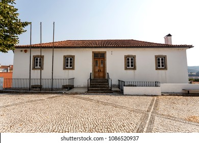 Facade of the old primary school building located in the churchyard of St Peter church of the town of Sertã, Portugal