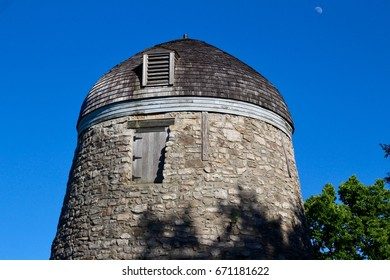 Facade of Old Windmill (Gristmill) With Blue Sky