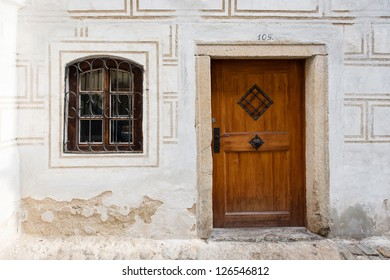 facade of old wooden house with wooden door and window