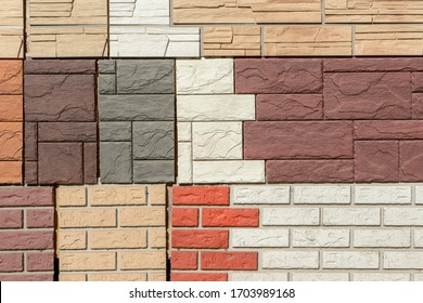 Facade panels with texture of stone wall for exterior and interior decoration of various colors and sizes are geometrically arranged. Abstract patterned background for your design.