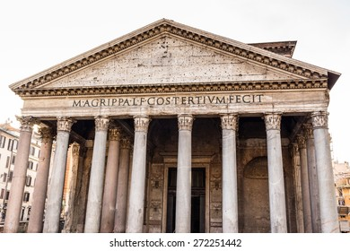 The facade of the Pantheon in Rome: columns and the pediment in a sunny winter day