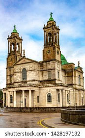 Facade of the parish church of Ss. Peter & Paul with their green domes in Athlone town, wonderful rainy day in the county of Westmeath, Ireland