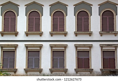 Facade of Portuguese era old building of 17th century with Corinthian style architecture windows in Old Goa, India